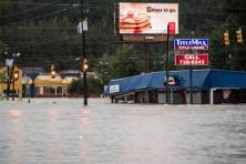 COLUMBIA, SC - OCTOBER 4: Flood waters rise around a title loan store on Garners Ferry Road October 4, 2015 in Columbia, South Carolina. South Carolina experiencied a record rainfall, with at leasrt 11.5 inches falling October 3. (Photo by Sean Rayford/Getty Images)