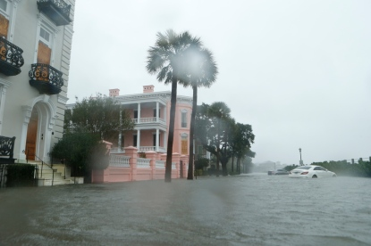 CHARLESTON, SC - OCTOBER 8: Cars are flooded along E. Battery Street adjacent to White Point Gardens in the wake of Hurricane Matthew on October 8, 2016 in Charleston, South Carolina. Florida, Georgia, South Carolina and North Carolina have all declared a state of emergency in for Hurricane Matthew. (Photo by Brian Blanco/Getty Images)